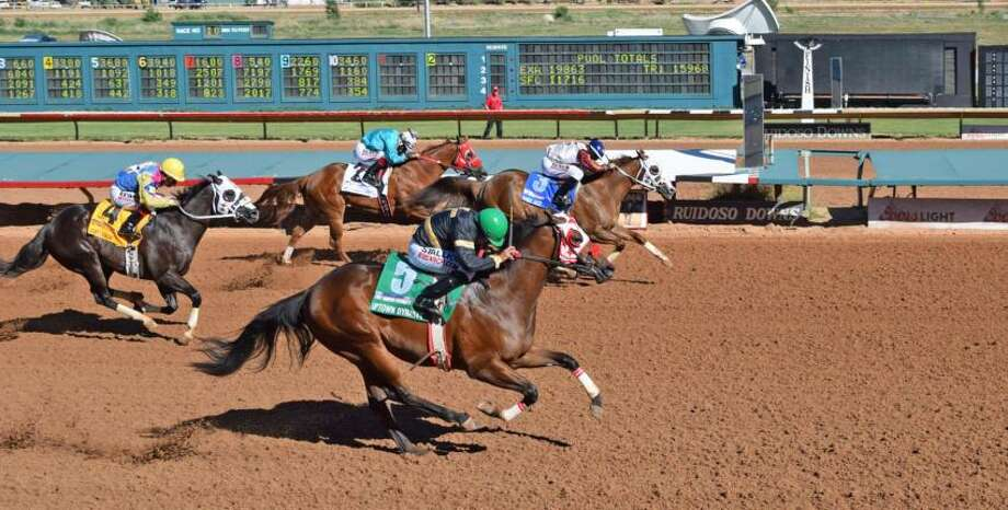 After finishing in a dead heat with Uptown Dynasty last month in the Ruidoso Futurity, Eagle Jazz (3) won by three-quarters of a length Sunday in the Rainbow Futurity. Photo: Courtesy Photo / Albuquerque Journal