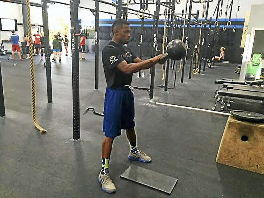 Jimmy Williams works out at Shoreline Athletics in Branford. Photo: David Borges — Register