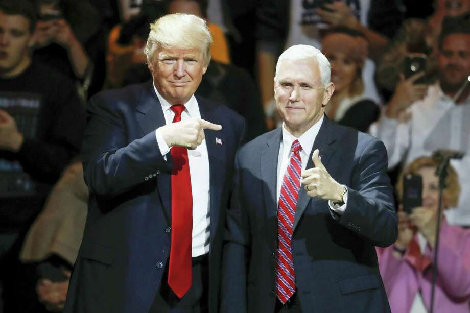 In this Dec. 1, 2016 photo, President-elect Donald Trump, left, and Vice President-elect Mike Pence acknowledge the crowd during the first stop of his post-election tour, in Cincinnati. Photo: AP Photo/John Minchillo, File   / AP