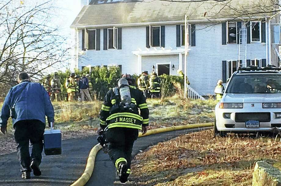 Crews from Branford and Guilford responded Tuesday morning after a fire broke out at a home on Granite Road. No one was hurt in the blaze. Photo: (Wes Duplantier/The New Haven Register)