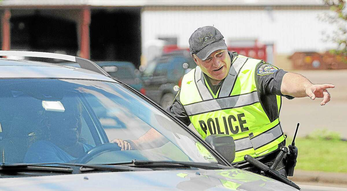 """Officer Jon Haddad stops a motorist at a checkpoint during the """"Click It or Ticket"""" Seat Belt Enforcement campaign."""