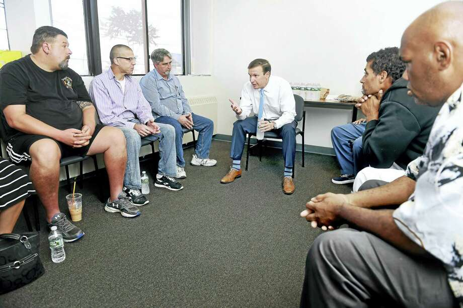 U.S. Sen. Chris Murphy, center, speaks at the ATP Foundation in New Haven with a group of individuals about opioid addiction. Photo: Arnold Gold — New Haven Register