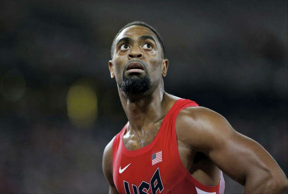 In this Aug. 23, 2015 photo, United States' Tyson Gay looks at his time from a men's 100-meter semifinal at the World Athletics Championships at the Bird's Nest stadium in Beijing. The 15-year-old daughter of Olympic sprinter Tyson Gay has been fatally shot in Kentucky, the athlete's agent and authorities said on Oct. 16, 2016. Photo: AP Photo/David J. Phillip, File   / Copyright 2016 The Associated Press. All rights reserved. This material may not be published, broadcast, rewritten or redistribu