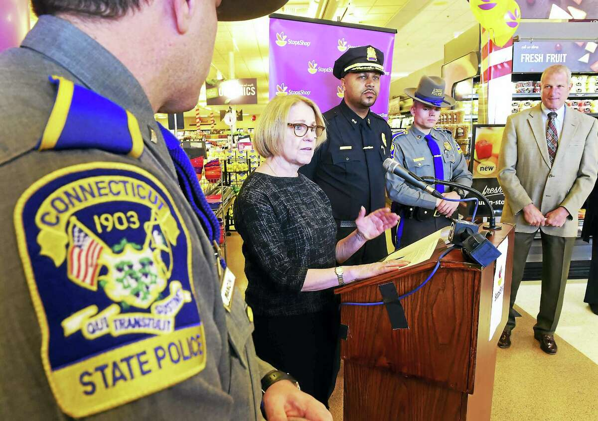 From left, Connecticut State Police Lt. Seth Mancini, state Public Safety Commissioner Dora Schriro, Shelton Police Chief Shawn Sequeira, State Police Trooper Tyler Wereden and Shelton Mayor Mark Lauretti, are seen at a press conference addressing holiday crime Tuesday in Shelton.