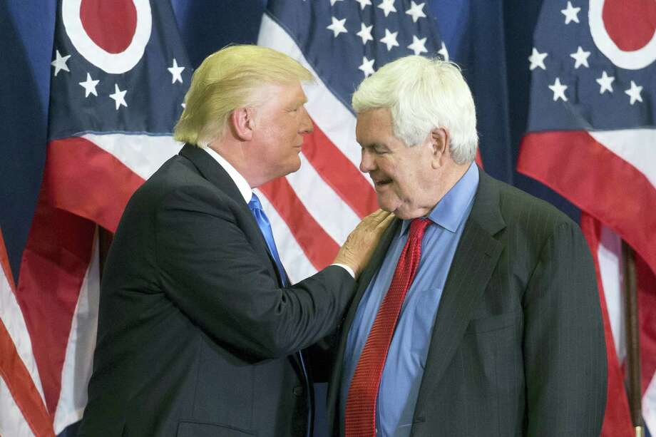 "In this photo taken July 6, 2016, Republican Presidential candidate Donald Trump and former House Speaker Newt Gingrich share the stage during a campaign rally  in Cincinnati. Running mate or not, ""Newt Gingrich is going to be involved with our government,"" Republican presidential candidate Donald Trump has said. Photo: AP Photo/John Minchillo    / AP"
