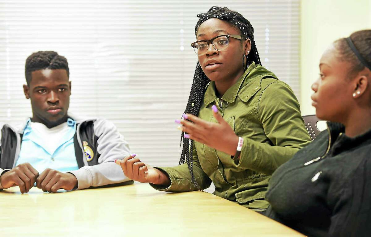 (Peter Hvizdak - New Haven Register) Metropolitan Business Academy juniors Henry Seyce of New Haven, Lattrese Martin of Hamden and Tia Stevens of New Haven discuss the 2016 presidential candidates with a New Haven Register reporter at the school Thursday.