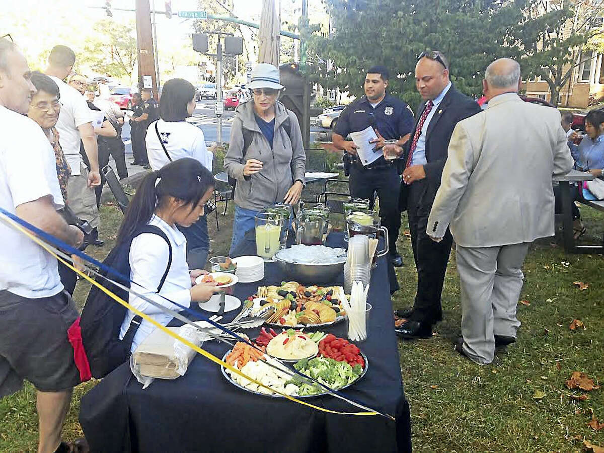 """The scene Friday outside St. Johns Episcopal Church for """"Koffee with a Cop."""""""