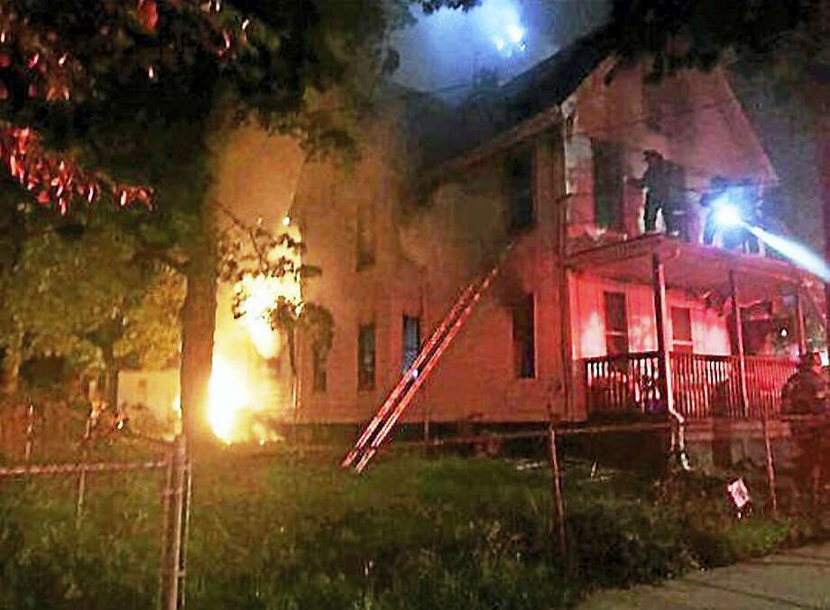 The American Red Cross is helping five people after a fire early Sunday on Downing Street in the Fair Haven section of New Haven. Photo: Photo Courtesy Of The New Haven Fire Department