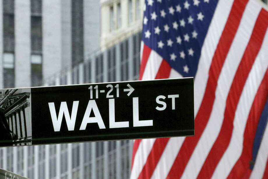 FILE - In this July 6, 2015 file photo, American flags fly at the New York Stock Exchange on Wall Street.  Stocks fell in early trading in Europe on Friday, Sept. 16, 2016, led by banks as Deutsche Bank shares tumbled following news the U.S. Justice Department is seeking a $14 billion settlement over its dealings in mortgage-backed securities before the 2008 financial crisis. Photo: Mark Lennihan — The Associated Press File  / Copyright 2016 The Associated Press. All rights reserved.