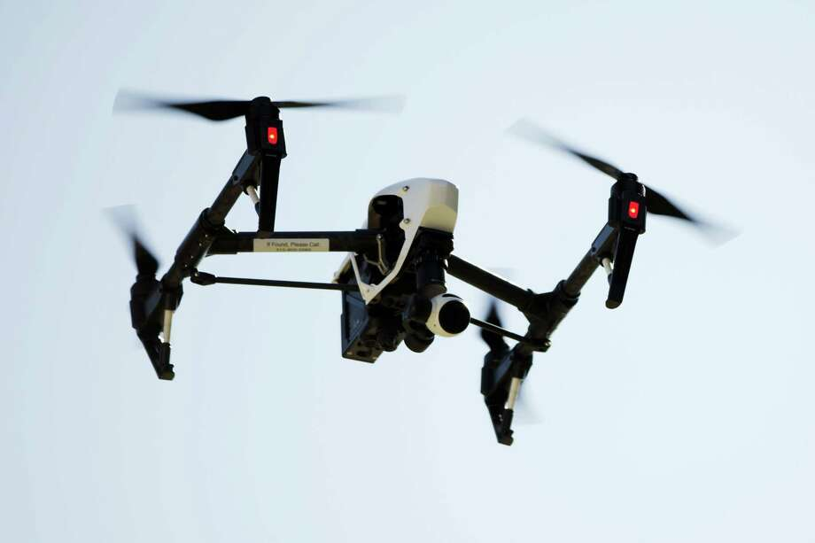 In this file photo, a drone captures videos and still images of an apartment building in Philadelphia. Photo: Matt Rourke — The Associated Press File   / Copyright 2016 The Associated Press. All rights reserved. This material may not be published, broadcast, rewritten or redistribu