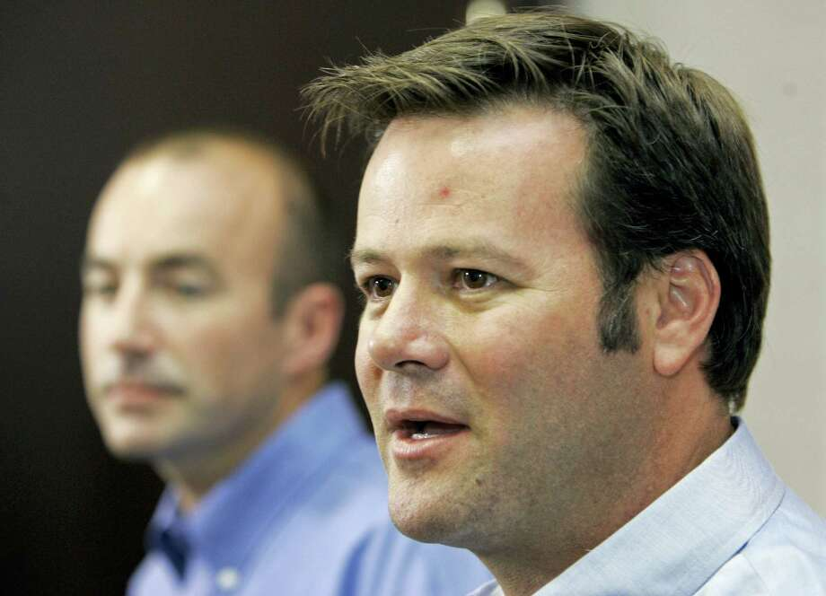 In this file photo, NASCAR racer Robby Gordon, right, answers a question during a news conference in Charlotte, N.C. Police said a husband and wife were found dead inside a home Wednesday in Orange and a neighbor said they were Gordon's father and stepmother. Photo: Chuck Burton — The Associated Press File   / AP2007