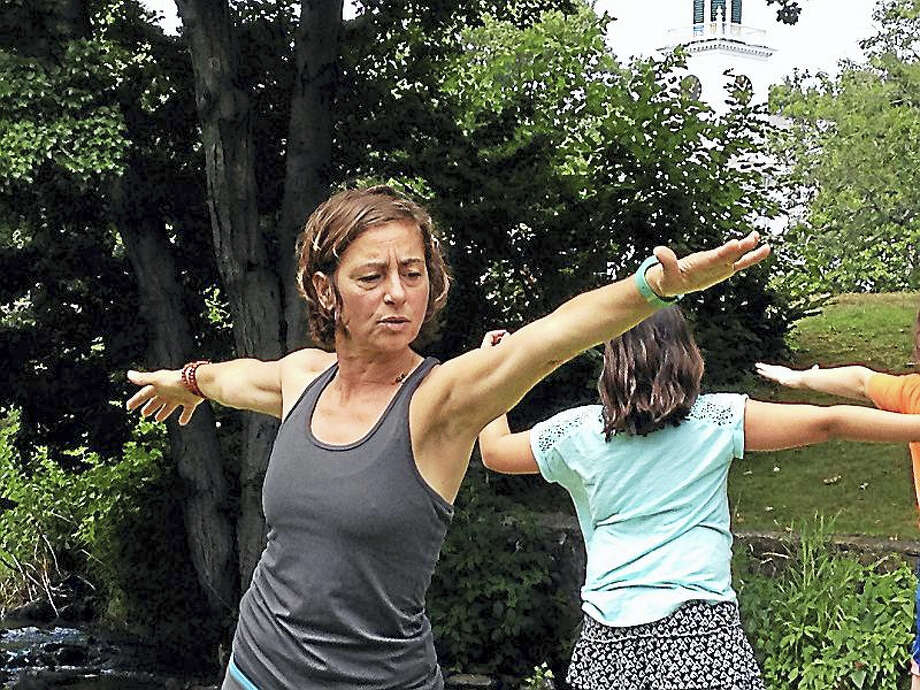 "Traci Weber, founder and owner of WalkAbout Yoga, gave a free class and demonstration by the duck pond during a recent session of ""River Street Wednesdays,"" a collaboration between the city and Milford Arts Council which provide entertainment in order to draw more people  downtown, especially the section not on the main city Green. Photo: Pam McLoughlin - New Haven Register"