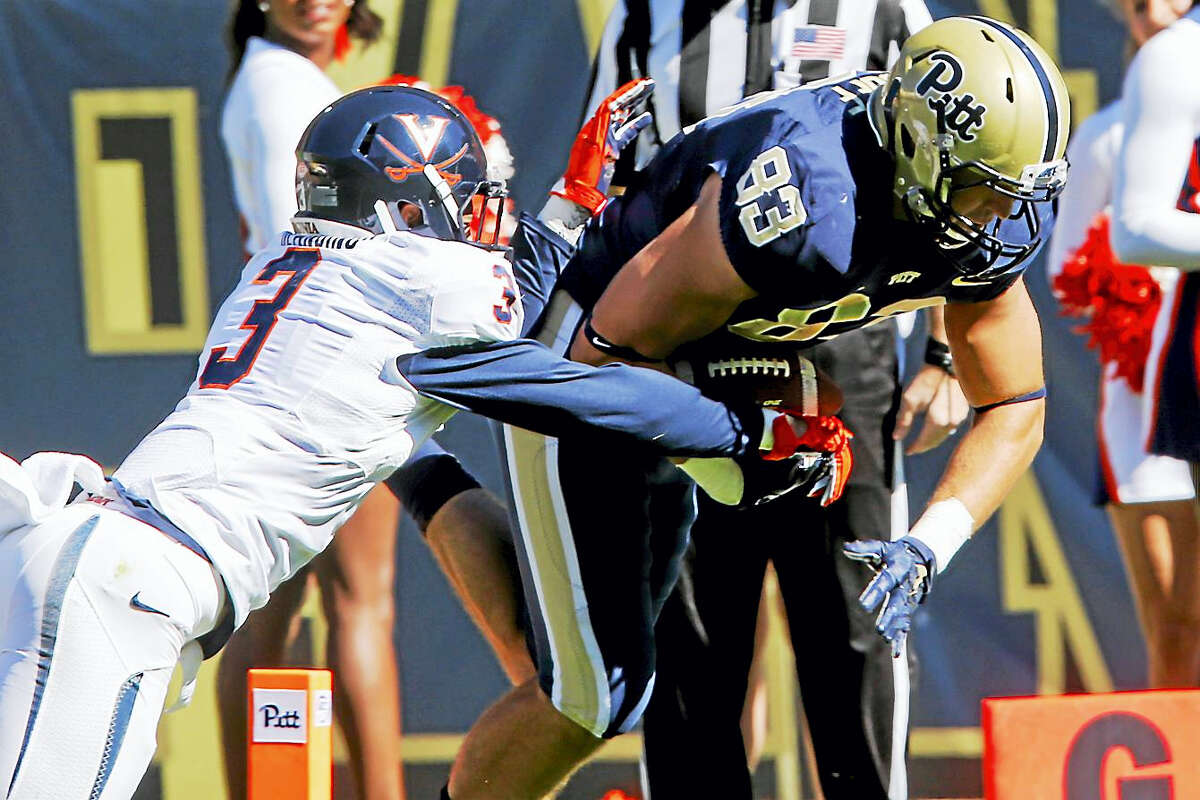 Virginia safety Quin Blanding makes a tackle during a game last season.