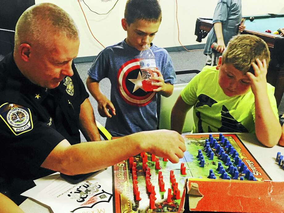 Seymour Deputy Police Chief Paul Satkowski interacts with children from the Boys and Girls Club. Photo: CONTRIBUTED PHOTO — Jesse Patrick