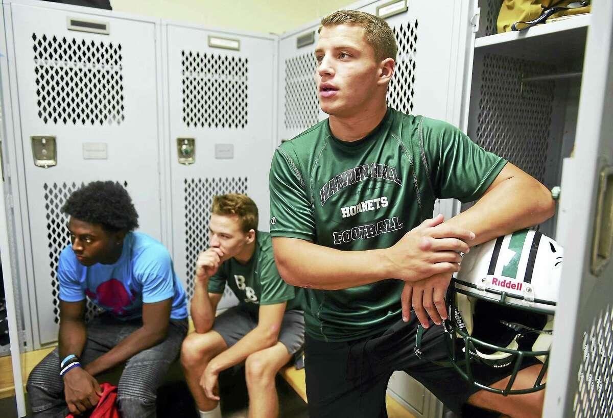 Corey Millhouse looks on during a Hamden Hall football team meeting on Thursday.