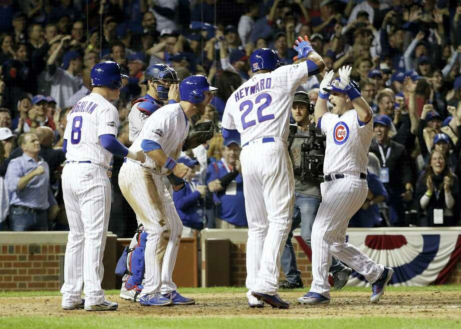 Chicago Cubs catcher Miguel Montero, right, celebrates after hitting a grand slam during the eighth inning of Game 1 of the NLCS on Saturday. Photo: David J. Phillips — The Associated Press   / Copyright 2016 The Associated Press. All rights reserved.