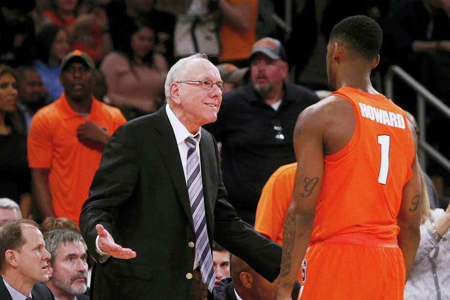 Syracuse coach Jim Boeheim talks to Syracuse's Franklin Howard (1) during the first half Monday. Photo: Jason DeCrown — The Associated Press    / FR103966 AP