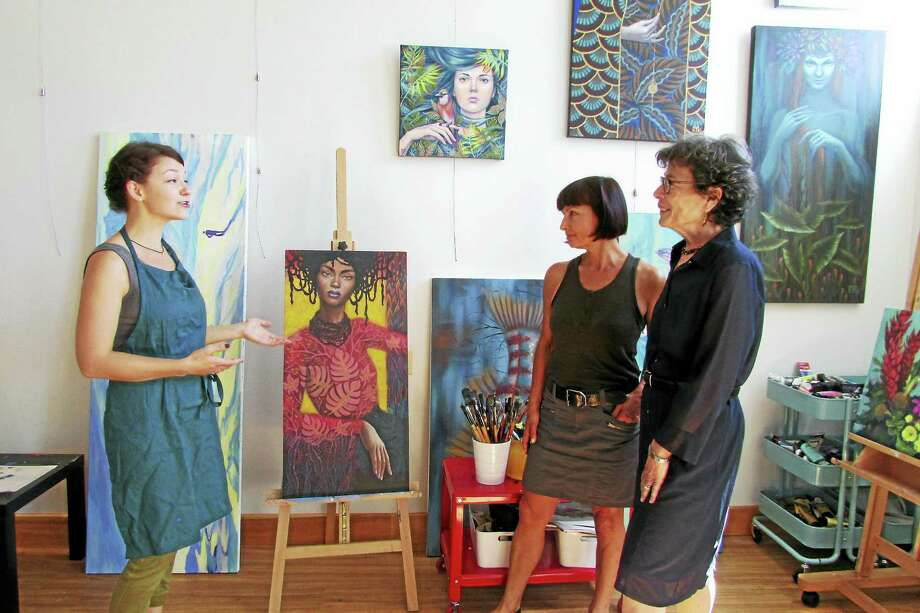 From left, Vasilisa Romanenko, Natasha Piskunova and Woodbridge First Selectman Ellen Scalettar at Palette Art Studio. Photo: CONTRIBUTED PHOTO