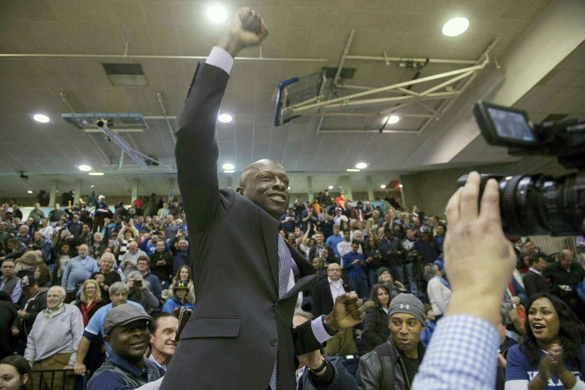 Yale men's basketball coach James Jones celebrates the win at the end of the second half of an NCAA Ivy League Conference basketball college game Saturday, March 5, 2016, in New York. Yale beat Columbia 71-55. (AP Photo/Bryan R. Smith)
