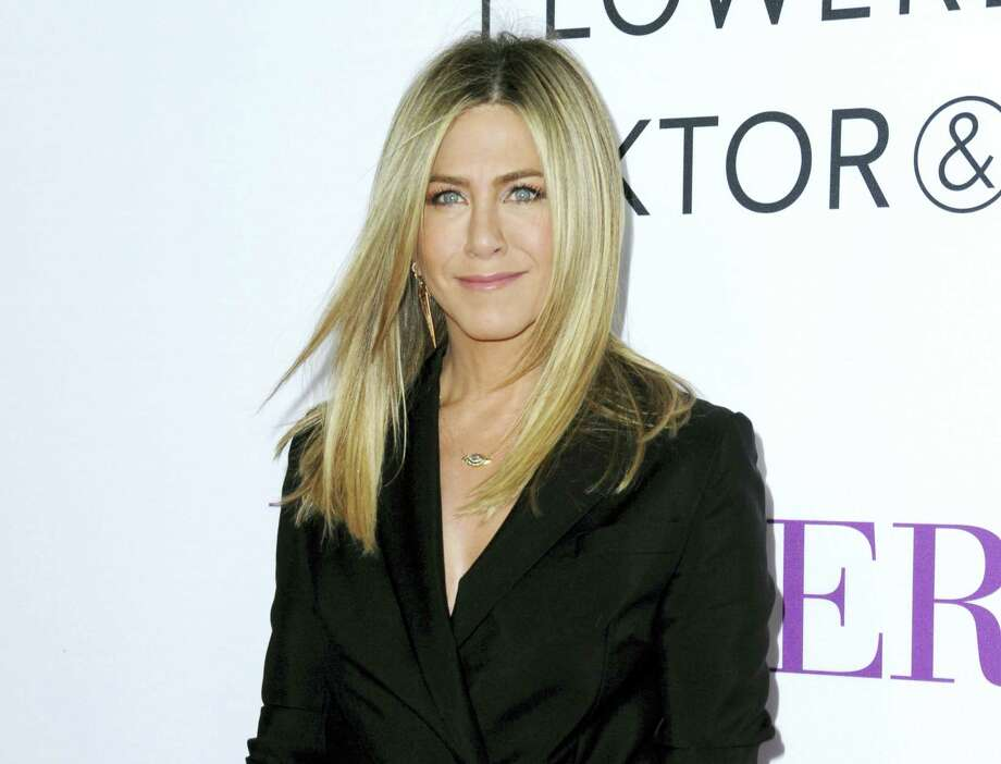 "In this April 13, 2016, file photo, Jennifer Aniston arrives at the Los Angeles premiere of ""Mother's Day."" Aniston says she's not pregnant and she's fed up with predatory tabloid culture that defines women by their looks and maternal status. Photo: Photo By Richard Shotwell/Invision/AP, File    / Invision"