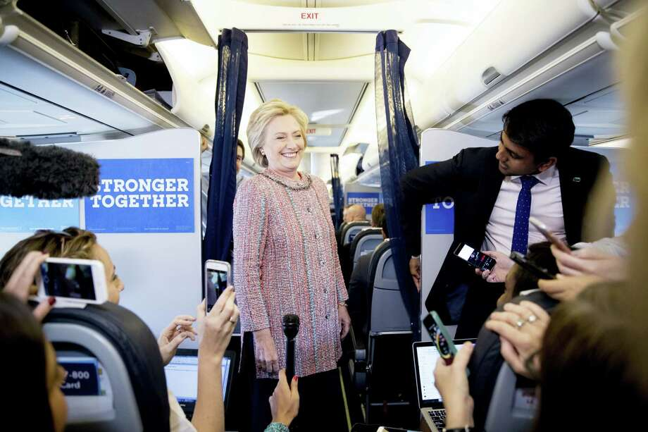Democratic presidential candidate Hillary Clinton laughs with members of the media on her campaign plane, in White Plains, N.Y., Thursday, Sept. 15, 2016, before traveling to Greensboro, N.C. for a rally. Clinton returned to the campaign trail after a bout of pneumonia that sidelined her for three days and revived questions about both Donald Trump's and her openness regarding their health. Photo: AP Photo/Andrew Harnik    / AP