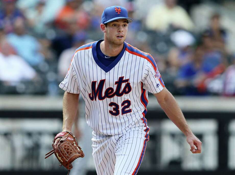 Mets starting pitcher Steven Matz looks toward first base as the Padres' Alexei Ramirez breaks up his no-hitter during the eighth inning on Sunday. Photo: Seth Wenig — The Associated Press   / Copyright 2016 The Associated Press. All rights reserved. This material may not be published, broadcast, rewritten or redistribu