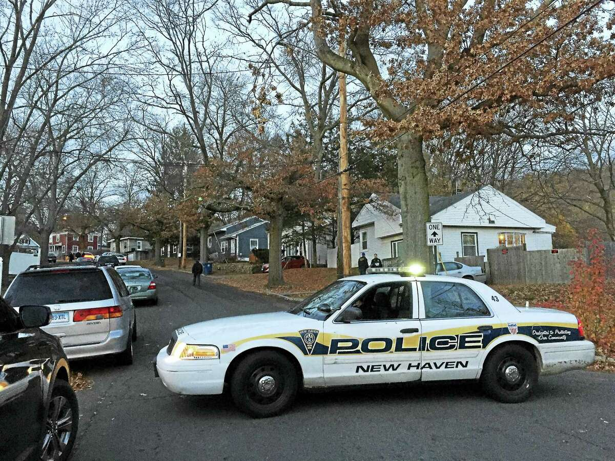 A New Haven police cruiser blocks a portion of Victory Drive Monday as police investigate a shooting death in the area.