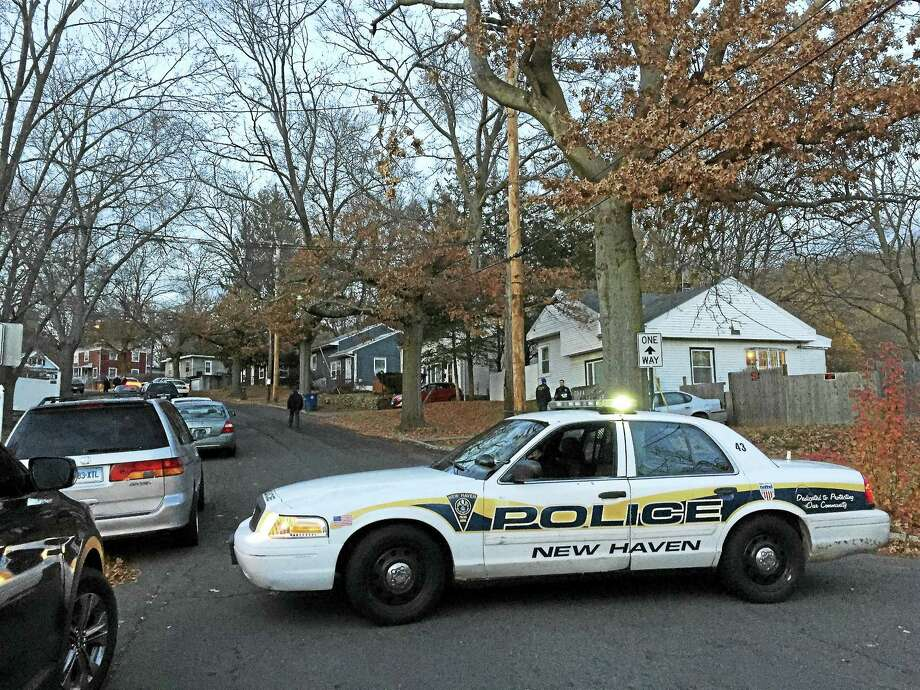A New Haven police cruiser blocks a portion of Victory Drive Monday as police investigate a shooting death in the area. Photo: Esteban L. Hernandez — New Haven Register