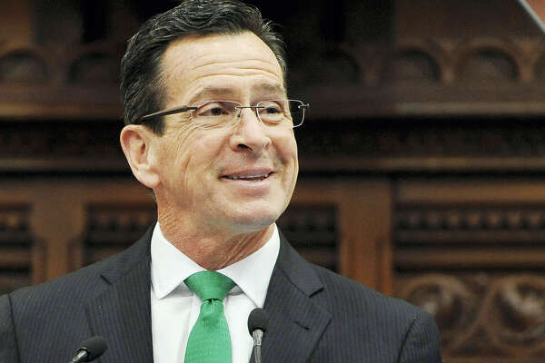 In this Jan. 7, 2015 photo, Connecticut Gov. Dannel P. Malloy smiles during the State of the State address to a joint session of the legislature in the House Chambers at the Capitol in Hartford, Conn.