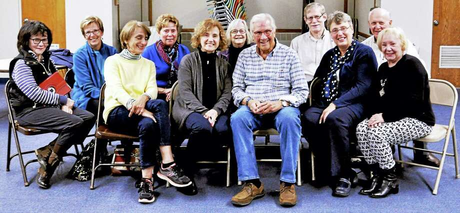 Members of the Silver Screen Movie Club last Wednesday night at the North Haven Parks and Recreation building. Front row, from left: Lee Fermo, Marge Quinn, Rich Ziemba, Dyann Zusi and Linda Kiely. Back row: Paula Schneider, Cathy Conklin, Kathy Tenedine, Ellen Hansen, Chris Zusi and Tom Tenedine. Photo: Contributed Photo — Brianna Cipollini