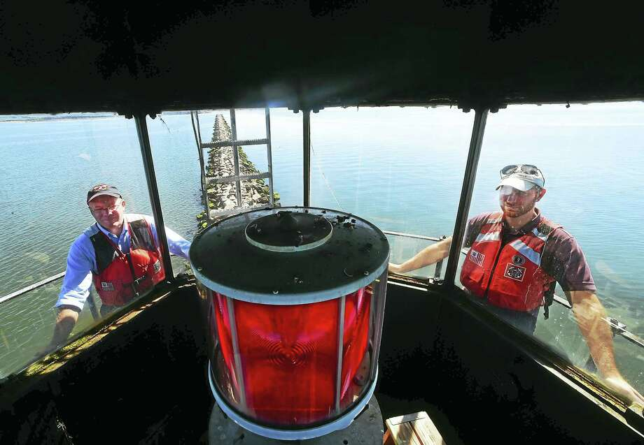 (Peter Hvizdak - New Haven Register)  Bob Zarnetski, General Services Administration regional administrator left, and Eric Giusti, GSA Real Estate Specialist and Southwest Ledge Lighthouse project manager, right, during a visit by prospective bidders  brought to the Southwest Ledge Lighthouse in New Haven Harbor. Photo: ©2016 Peter Hvizdak / ©2016 Peter Hvizdak