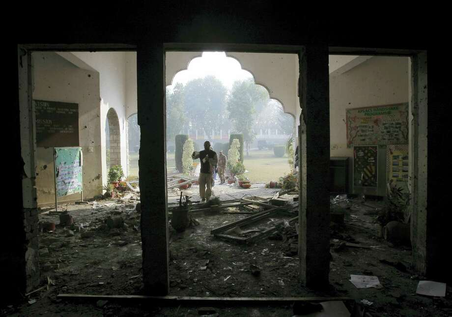 In this Dec. 17, 2014, file photo, a Pakistan army soldier inspects the Army Public School that was  attacked a day before by Taliban gunmen, in Peshawar, Pakistan. The Pakistani army said Wednesday, July 13, 2016, that the mastermind of the 2014 attack on an army-run school has been killed in a U.S. drone strike. A Pakistani military spokesman says that a U.S. Army general confirmed the death of Taliban leader Khalifa Umar Mansoor in a phone call to Pakistan's army chief. Photo: AP Photo/B.K. Bangash, File    / Copyright 2016 The Associated Press. All rights reserved. This material may not be published, broadcast, rewritten or redistribu