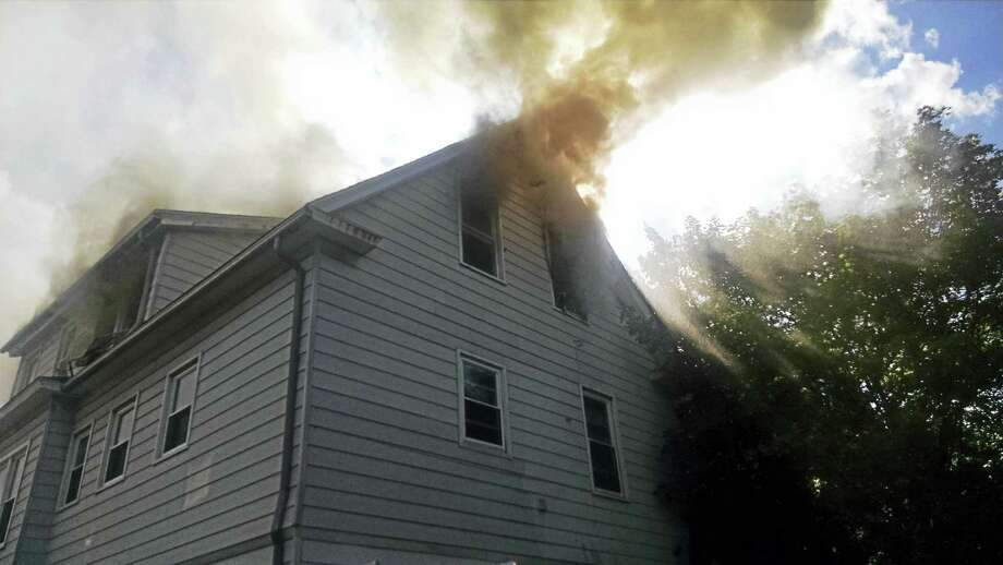 A third-floor fire at 75 Beacon St. in Hamden proved physically difficult for firefighters in the 90-degree heat and humidity Sunday afternoon, officials said. One fire lieutenant was transported to Yale-New Haven Hospital for heat exhaustion and dehydration; he was expected to be discharged Sunday evening. There were no additional civilian or fire department injuries, Hamden authorities said. The American Red Cross was called to assist seven displaced residents. Photo: Hamden Fire Department Photo