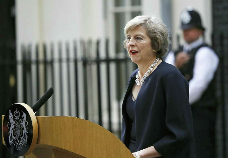 New British Prime Minister Theresa May speaks to the media as she arrives at her official residence,10 Downing Street in London, on Wednesday. Photo: ASSOCIATED PRESS   / Copyright 2016 The Associated Press. All rights reserved. This material may not be published, broadcast, rewritten or redistribu