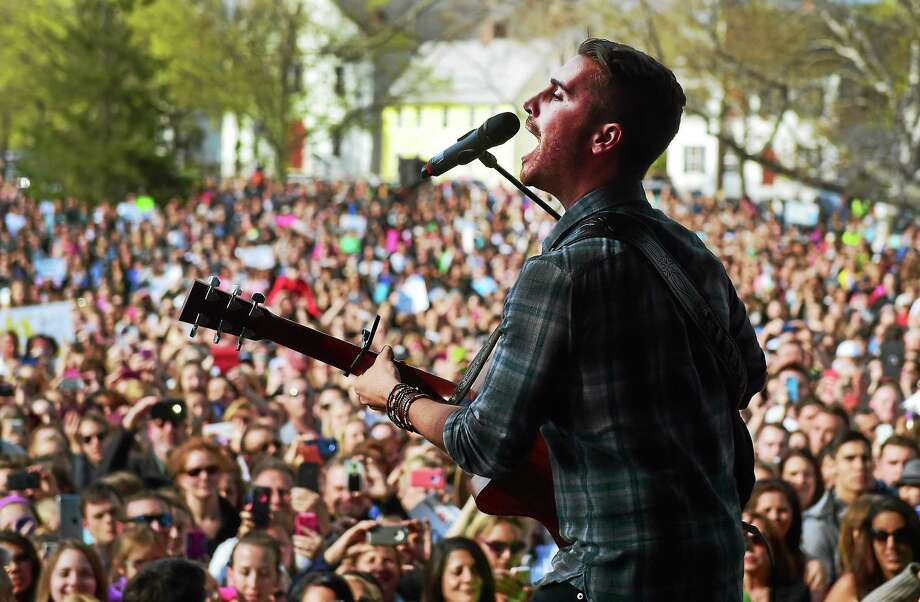 (Peter Hvizdak - New Haven Register)  American Idol's Nick Fradiani of Guilford, performs a concert on the Guilford Green after a welcome home parade on Whitfield Street in Guilford, Connecticut Friday, May 1, 2015. Photo: ©2015 Peter Hvizdak / ?2015 Peter Hvizdak