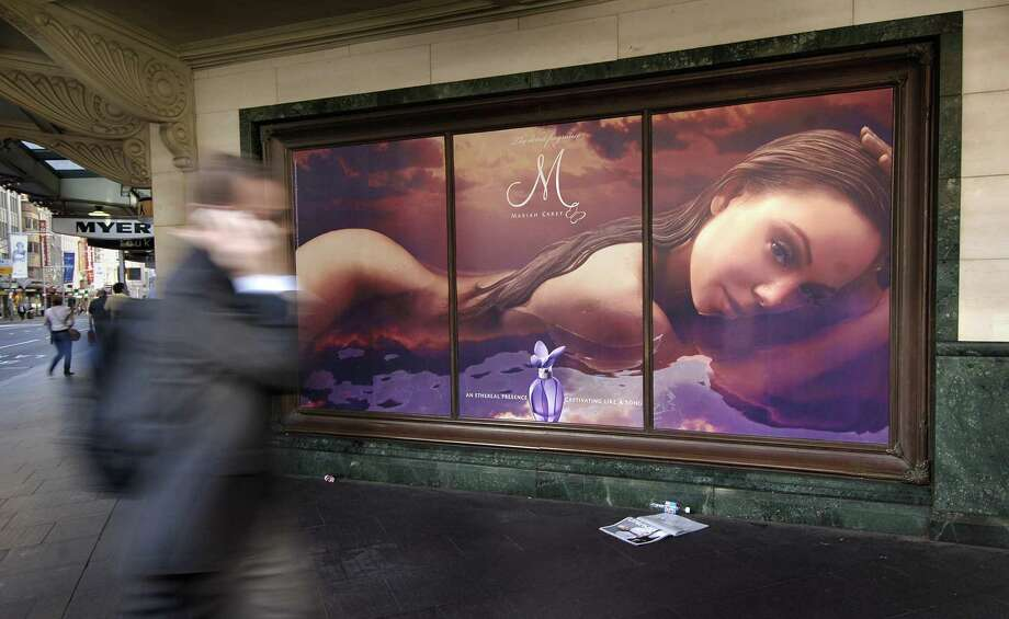 A man passes an ad for perfume by Mariah Carey in Sydney, Australia, in 2007. Celebrity perfumes are on the decline now as so-called artisanal fragances are growing in popularity. Photo: Jack Atley — Bloomberg   / Bloomberg