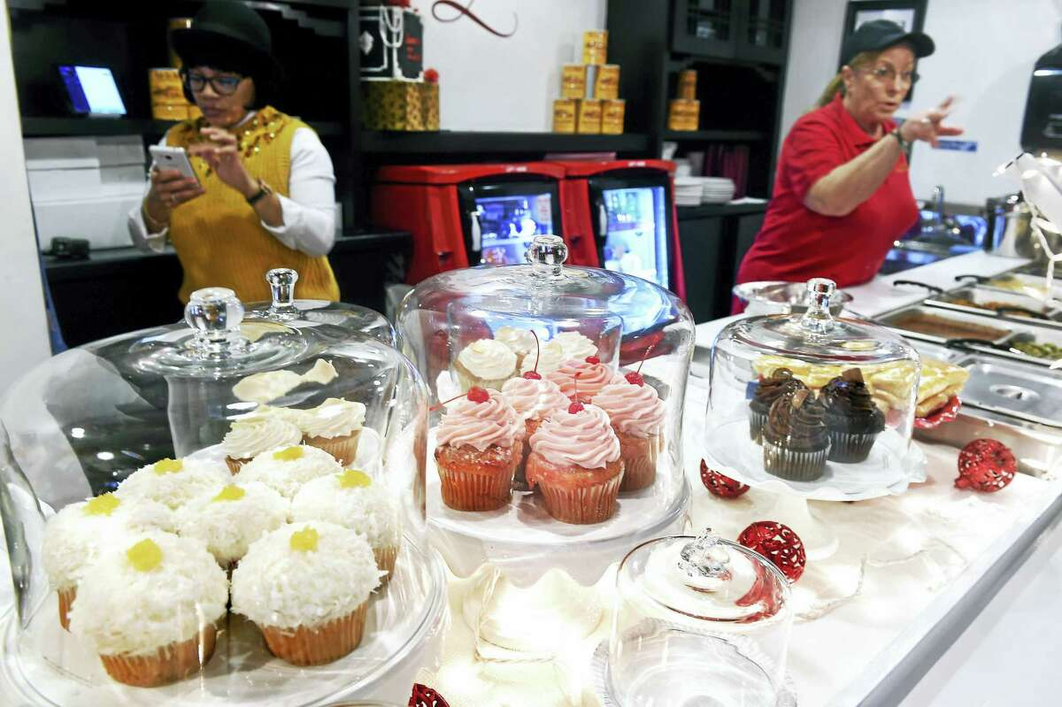 Cupcakes grace the counter at Queen Zuri New Orleans Delicacies on College Street in New Haven Monday.