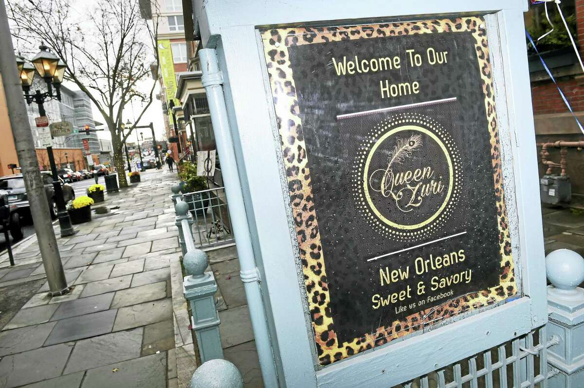 A sign advertises Queen Zuri New Orleans Delicacies on College Street in New Haven Monday.