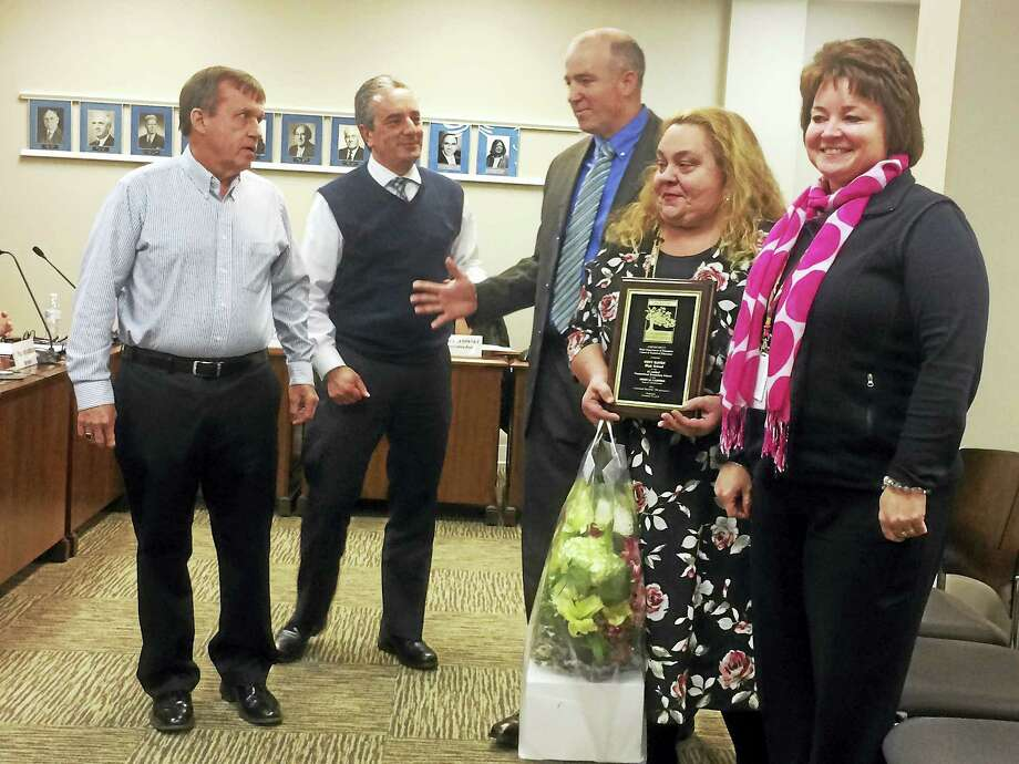 West Haven High School nursing teacher Valerie Cosenza, second from right, is honored at Monday night's Board of Education meeting after her class took top honors in a statewide nursing assessment for the second time in three years. Joining her, from left, are board Chairman Jim Morrissey, Superintendent of Schools Neil Cavallaro, Career and Technical Education Department Chairman Eric Rice and WHHS Principal Pamela Gardner. Photo: MARK ZARETSKY — NEW HAVEN REGISTER