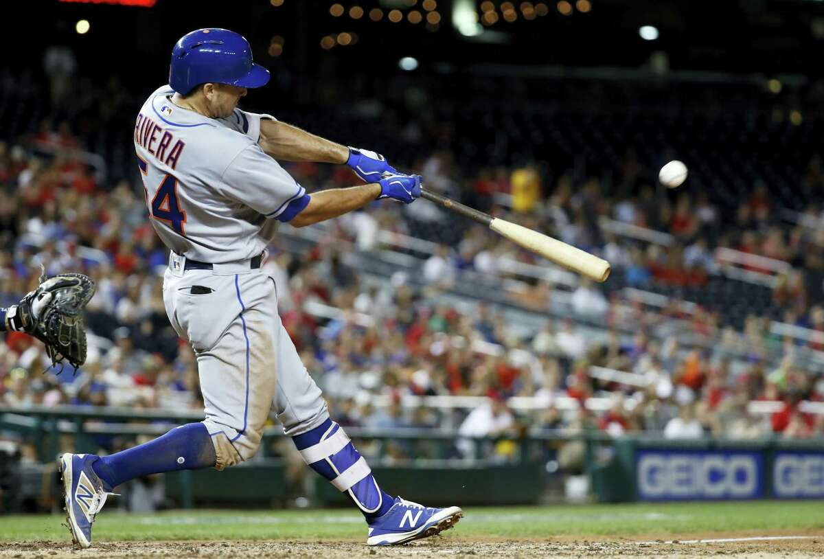 New York'S T.J. Rivera hits the game-wining solo home run during the top of the 10th inning against the Washington Nationals in Washington, D.C. The Mets won 4-3 in 10 innings.