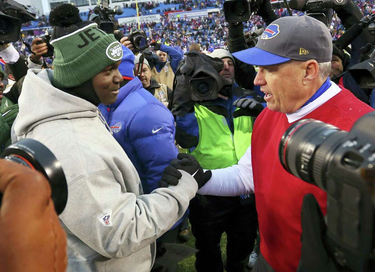 In this Jan. 3, photo, New York Jets head coach Todd Bowles, left, and Buffalo Bills head coach Rex Ryan, right, shake hands after the Bills' 22-17 win in an NFL football game in Orchard Park, N.Y. The Jets are heading to Orchard Park for an AFC East showdown against the Bills on Thursday night.