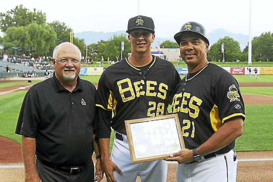 Photo courtesy of Salt Lake Bees  Troy Scribner, center, is presented the PCL pitcher of the week award by Salt Lake Bees general manager Marc Amicone, left, and manager Keith Johnson. Photo: Journal Register Co.