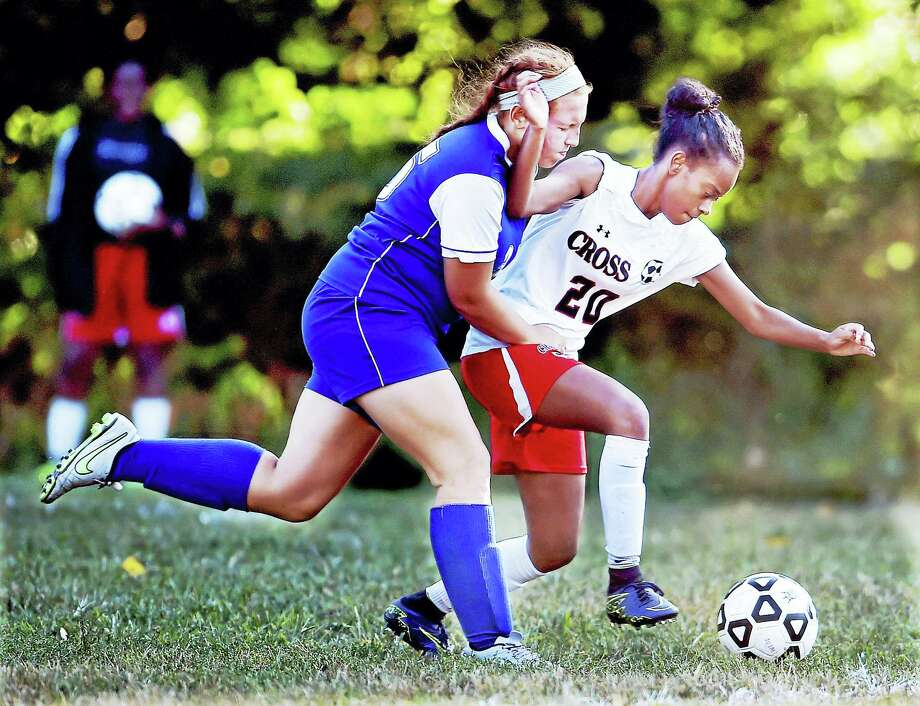 Wilbur Cross' Makayla Bigard battles West Haven's Alyza Bardieri in a 5-2 win Tuesday for the Westies at Rice Field at East Rock Park in New Haven. Photo: Catherine Avalone/New Haven Register   / New Haven RegisterThe Middletown Press