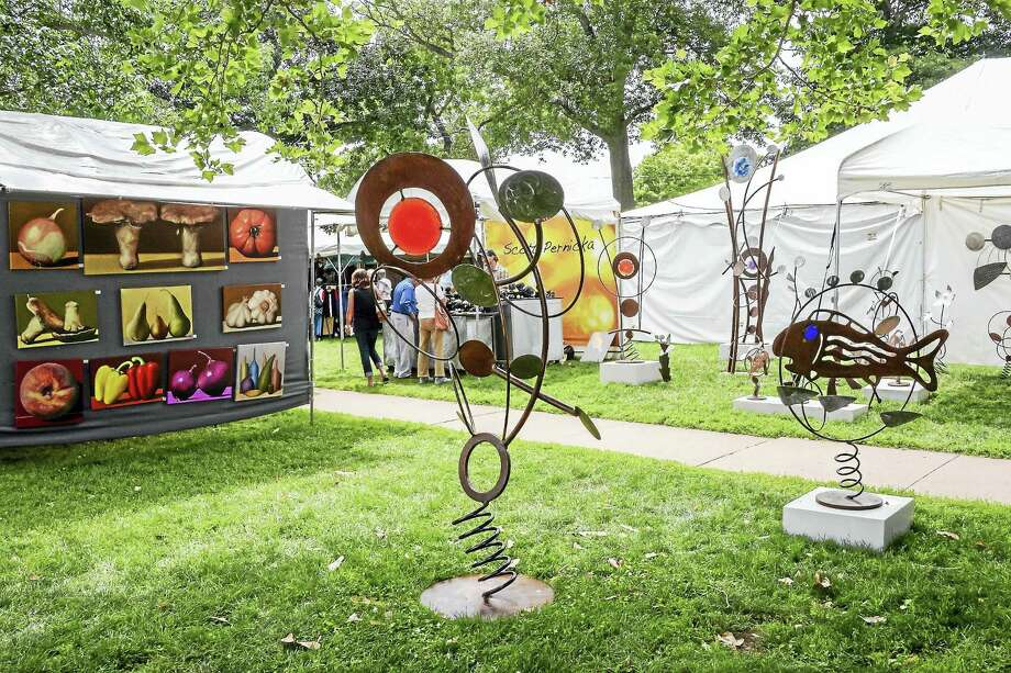 Art on the Guilford Green and the white tents are a sign the Guilford Art Center Craft Expo is here. It starts this weekend. Photo: Contributed   / Kelley Fryer/Guilford Courier
