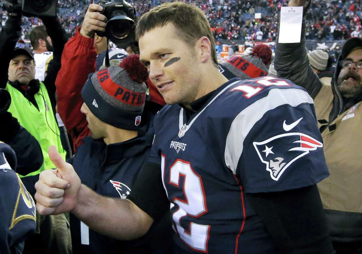 Patriots quarterback Tom Brady gives a thumbs-up after speaking to Rams quarterback Jared Goff on Sunday.