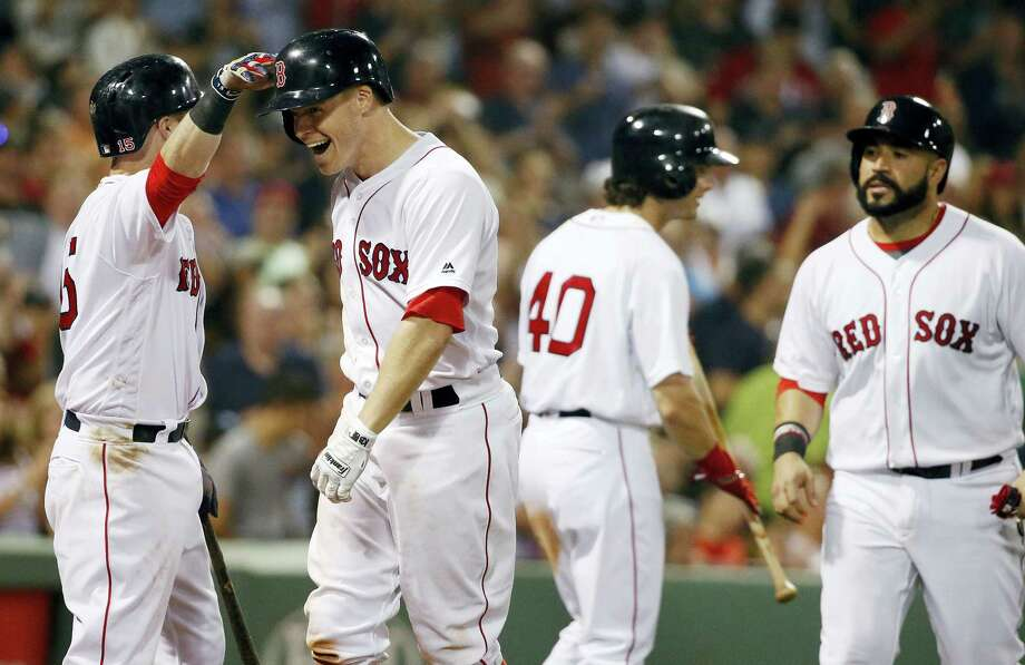 Brock Holt, second from left, celebrates his two-run home run in the sixth inning on Saturday. Photo: Michael Dwyer — The Associated Press   / Copyright 2016 The Associated Press. All rights reserved. This material may not be published, broadcast, rewritten or redistribu