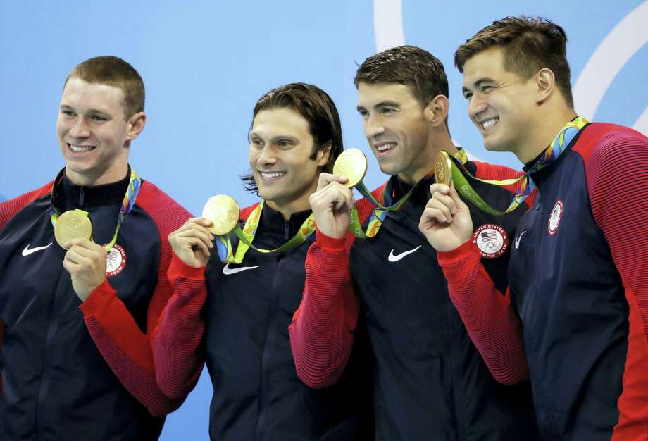 From left, Ryan Murphy, Cody Miller, Michael Phelps and Nathan Adrian display their gold medalsafter winning the 4x100-meter medley relay on Saturday. Photo: Rebecca Blackwell — The Associated Press   / Copyright 2016 The Associated Press. All rights reserved. This material may not be published, broadcast, rewritten or redistribu