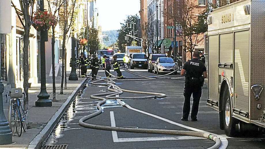 Part of Orange Street in New Haven was shut down and three buildings were evacuated after a gas leak Wednesday morning. Firefighters were still searching for the source late Wednesday morning. Photo: Wes Duplantier — The New Haven Register
