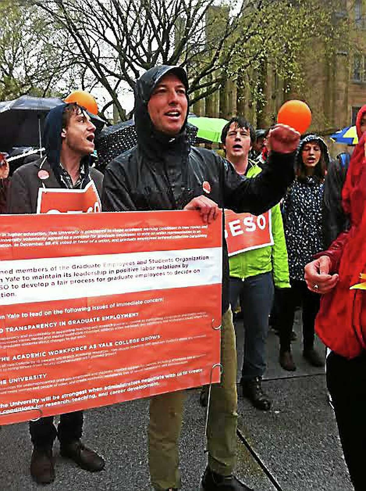 Jim Shelton — New Haven Register/File GESO Chair Aaron Greenberg, center, leads a rally asking Yale University to agree to a unionization vote for graduate students.