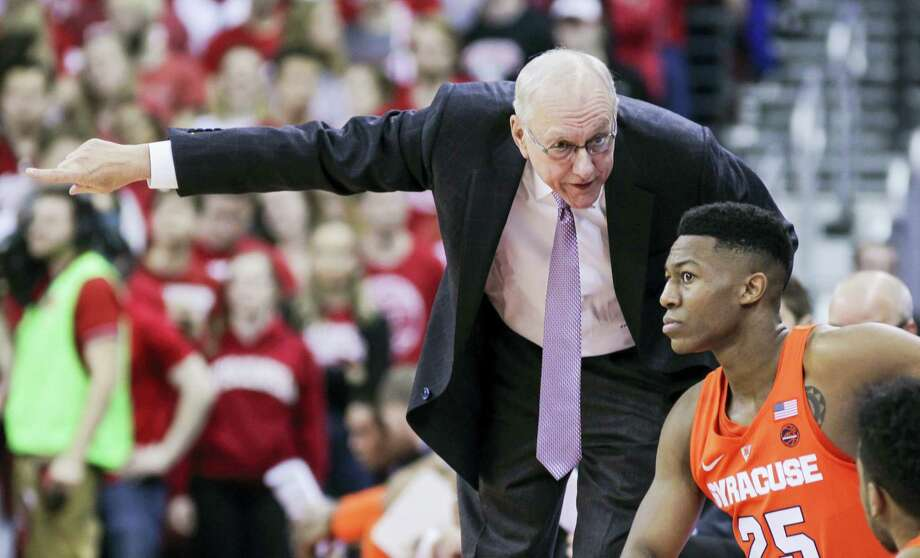 Syracuse coach Jim Boeheim talks with Tyus Battle during a recent game. Photo: The Associated Press    / FR19153 AP